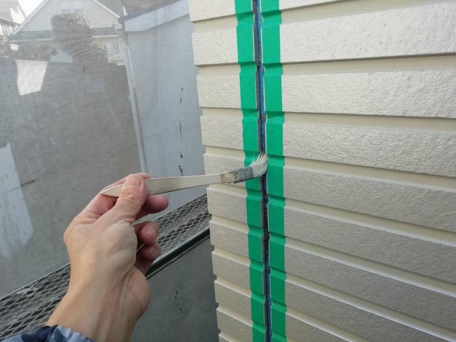 西宮市外壁サイディング壁プライマー作業